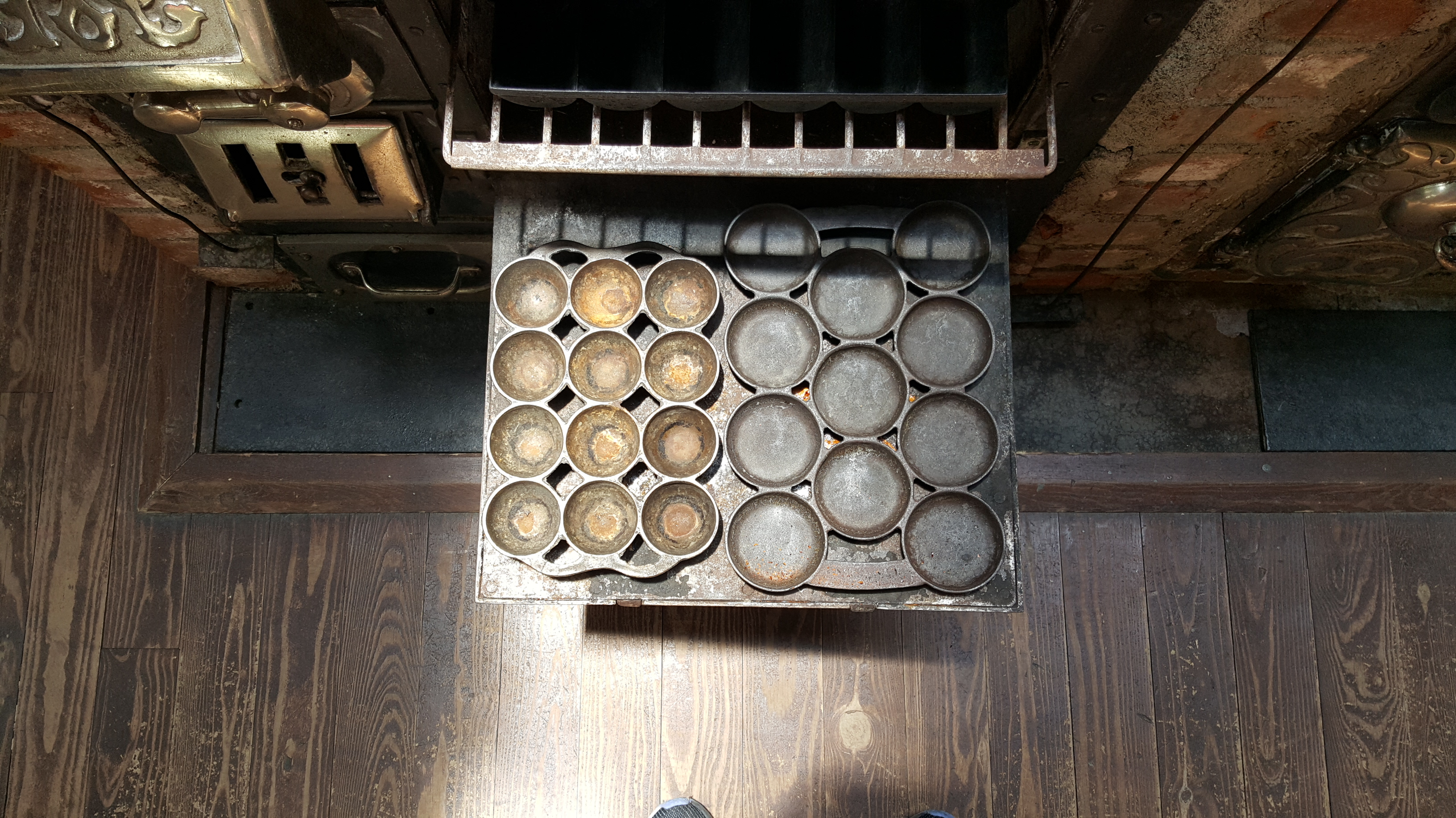 Inside Louis Dupuy's kitchen. A view down at the (not original) stove.