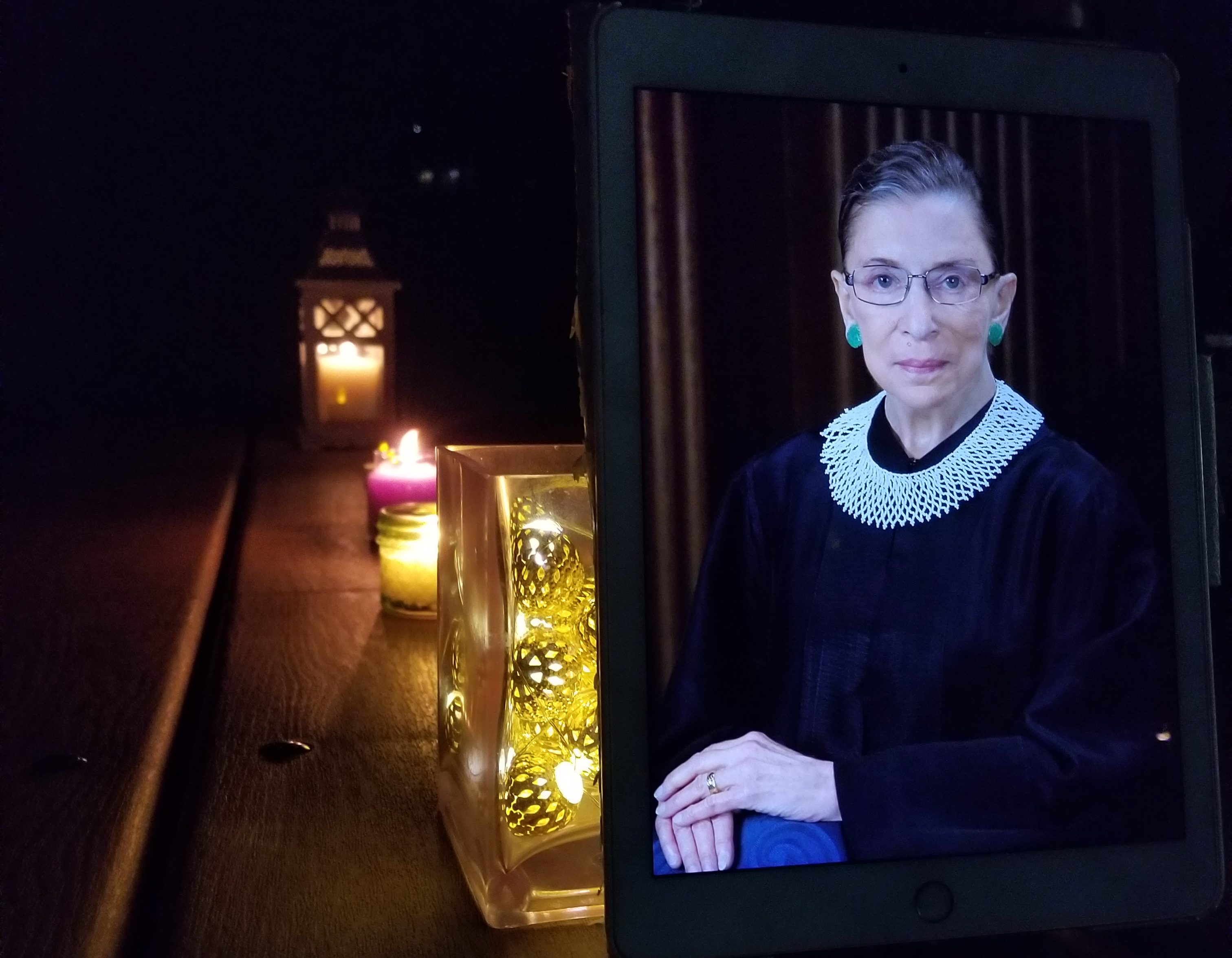Image of RBG at a candlelight vigil.